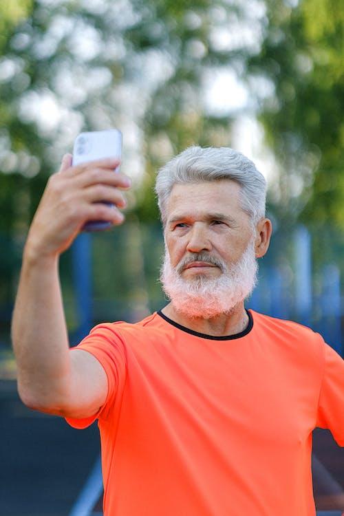 Confident senior man taking self portrait