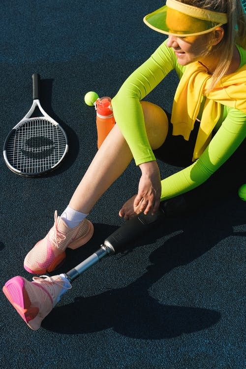 Woman in Yellow Long Sleeve Shirt and Yellow Pants Holding White and Black Electric Fly Swatter
