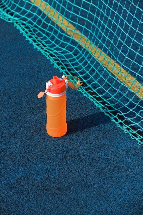 Bottle of water on sport ground