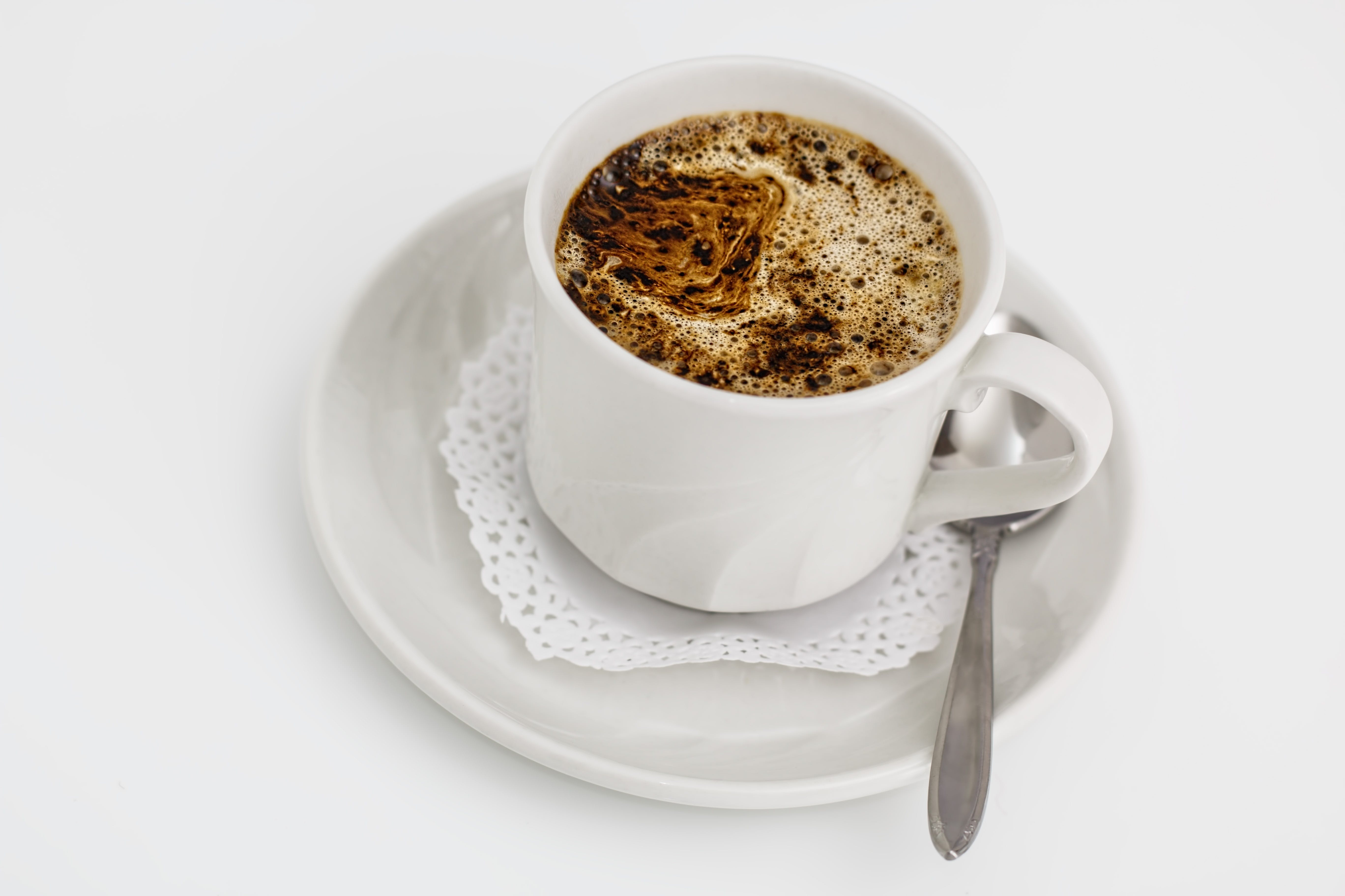 White Ceramic Cup With Coffee
