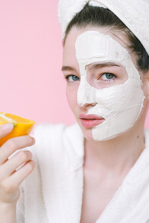 Calm woman with facial mask