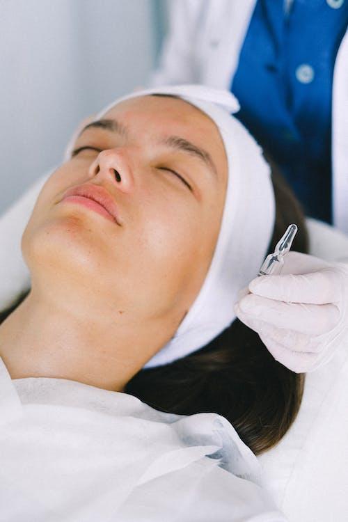 Attractive woman lying in beauty salon