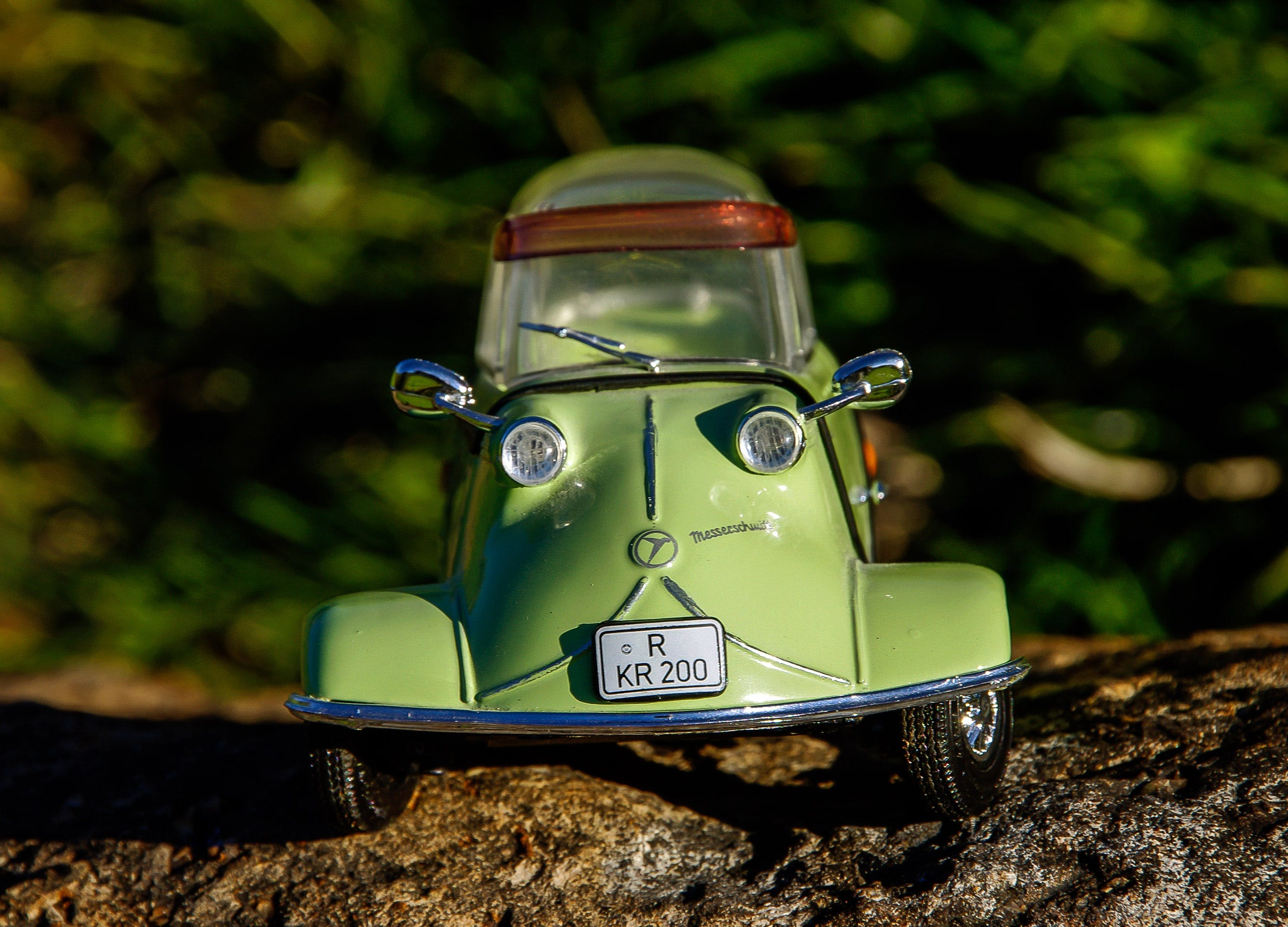 Green and Gray Miniature Car Toy