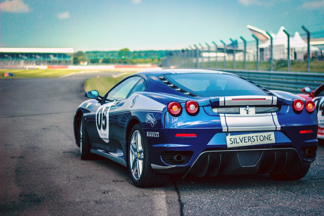 Silverstone Blue Silver Stripe Race Car on Track