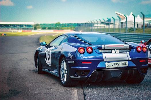 Silverstone Blue Silver Stripe Race Car on Track