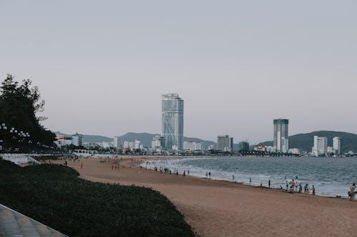 Crowded embankment near waving sea