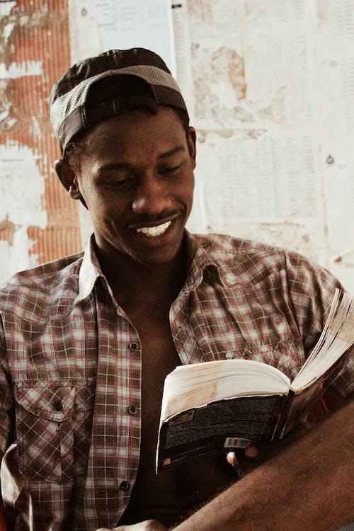 Happy black man reading book