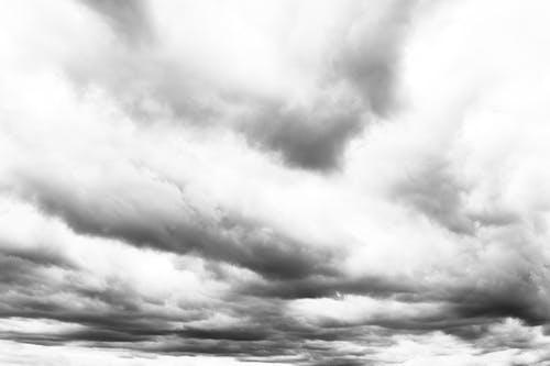 Heavy cumulus clouds on overcast sky
