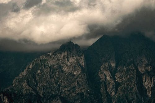 Dramatic cloudy sky over rough mountains peaks