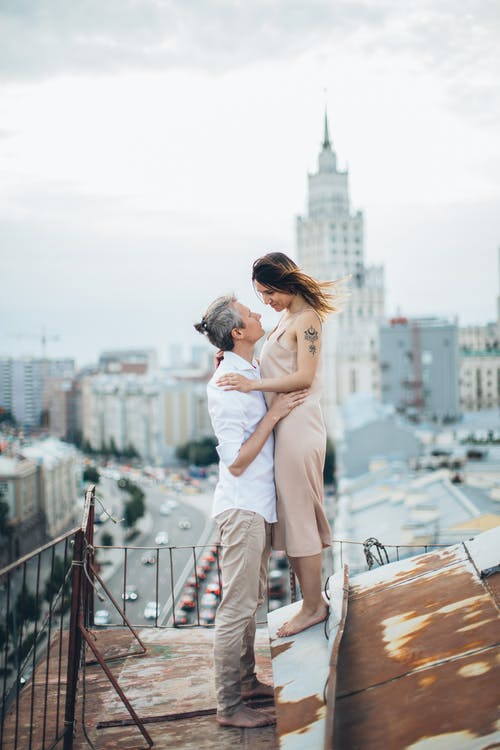 Loving couple embracing on rooftop in city