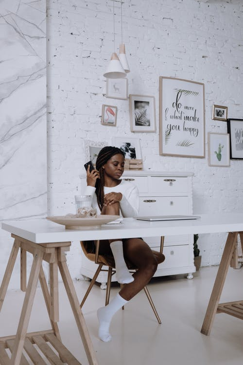 Woman in White Shirt Sitting on Chair