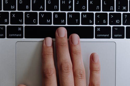 Persons Hand on Macbook