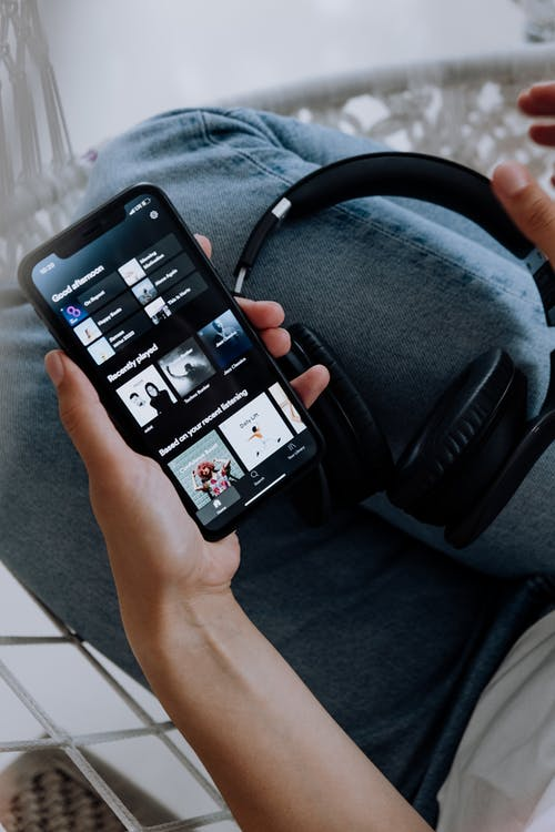 Person Using Spotify on an Iphone