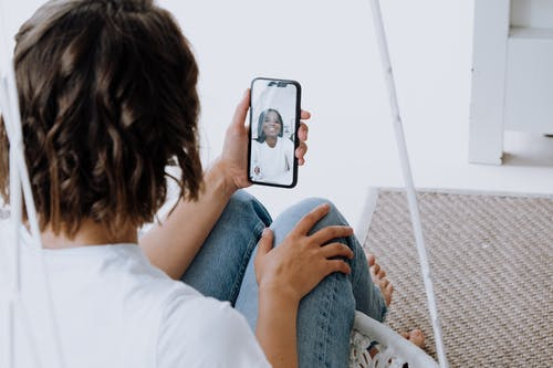 Woman in White Shirt Holding Iphone 6