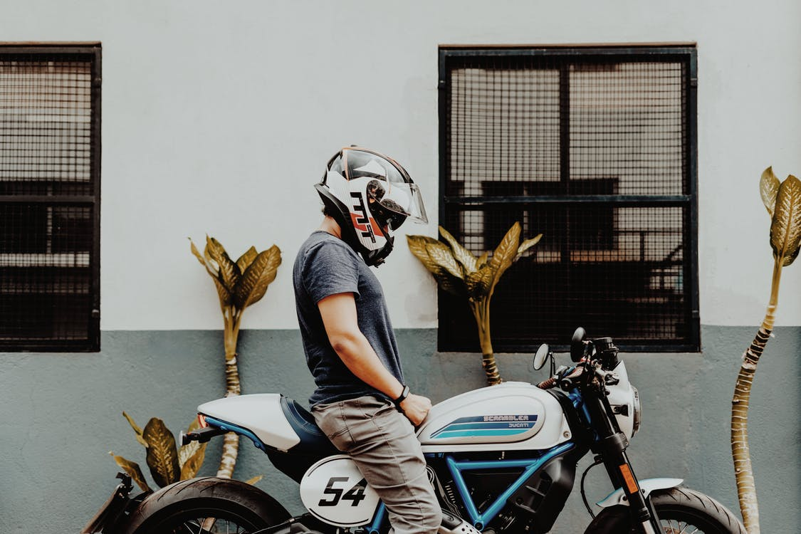 Man in Gray T-shirt Riding White and Blue Motorcycle