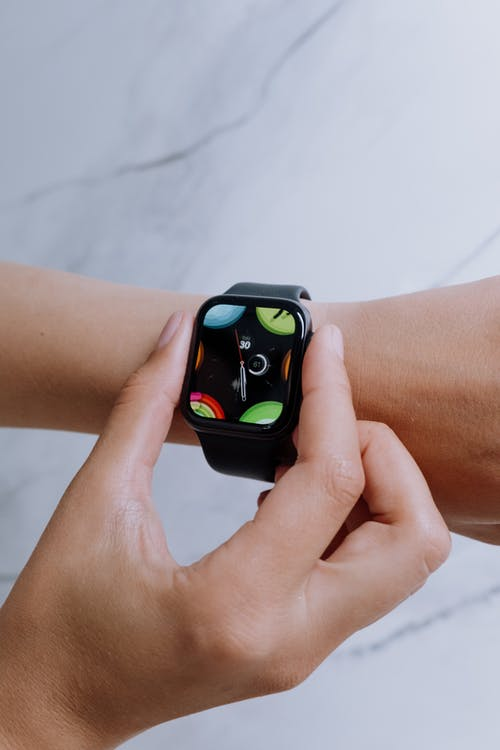 Person Wearing Black and Green Apple Watch