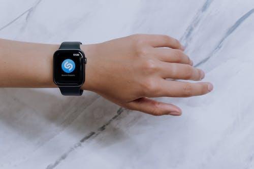 Person Wearing Black Apple Watch