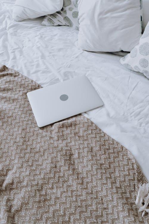 Silver Macbook on White Textile