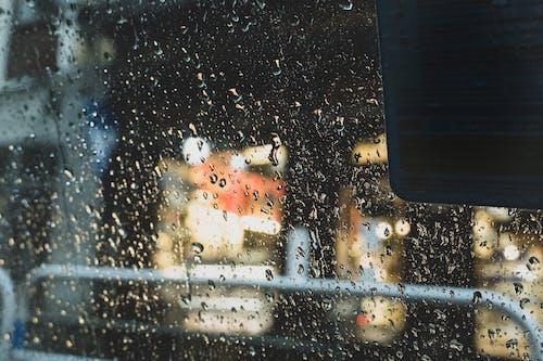 Kostenloses Stock Foto zu lluvia, madrid, restaurante, taxi