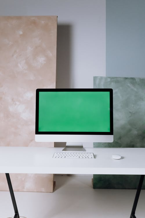 Silver Imac on White Wooden Table