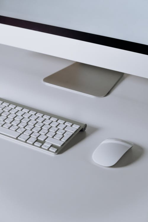 Silver Imac and Apple Magic Keyboard