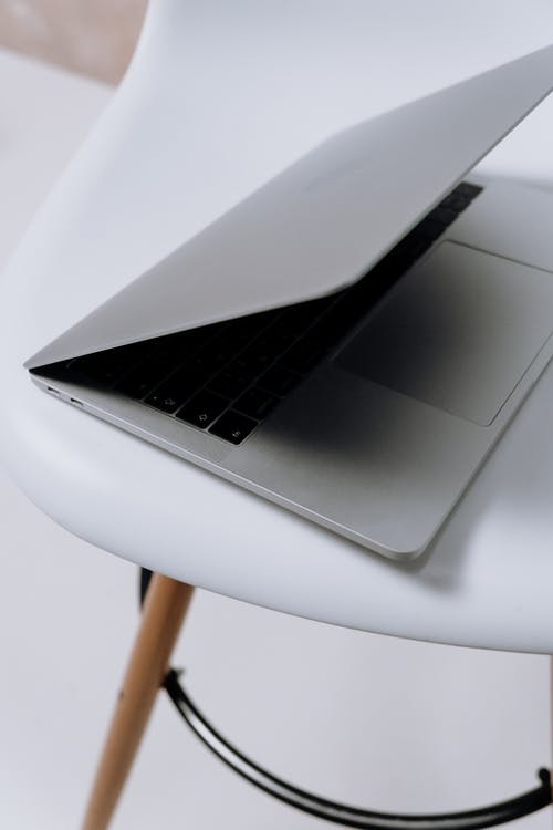 Macbook Pro on White Table