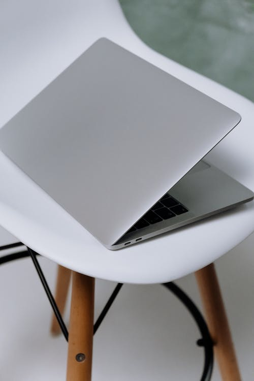 Macbook Air on White Round Table
