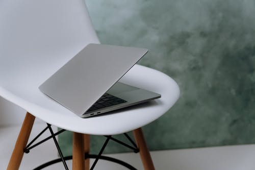 Macbook Pro on White Chair