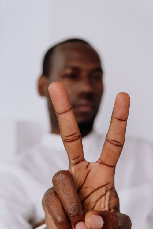 Man in White Dress Shirt Showing His Middle Finger