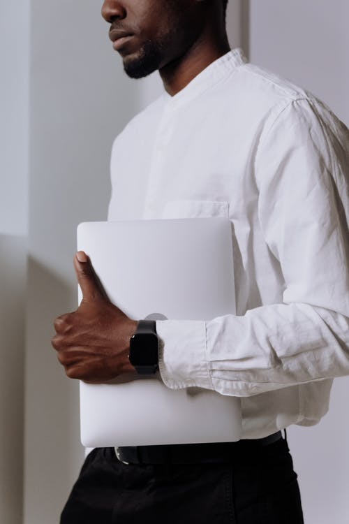 Man in White Dress Shirt Holding White Paper