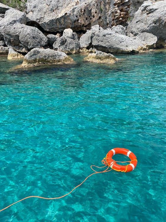 Lifebuoy floating on turquoise water
