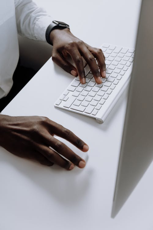 Person Holding White Apple Keyboard