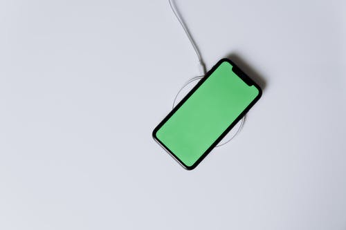 Green Iphone 5 C on White Surface
