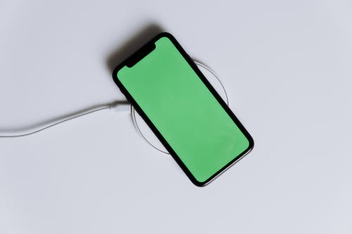 Green Iphone Case on White Surface