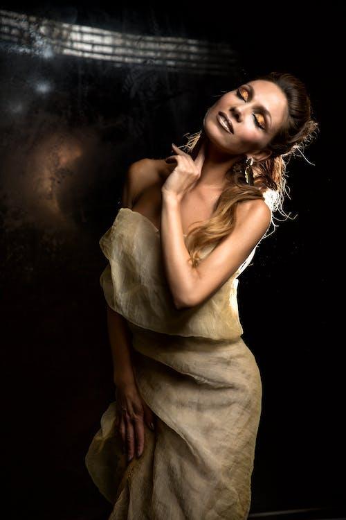 Woman in Beige Sleeveless Dress