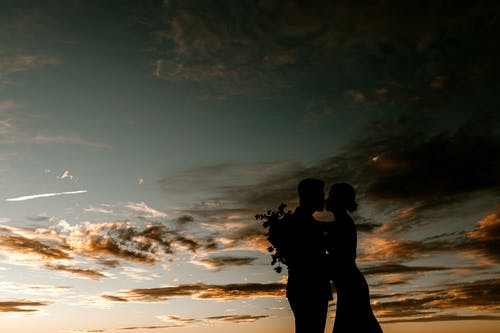 Silhouette of couple on picturesque sunset