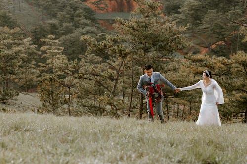 Happy newlywed having fun in field