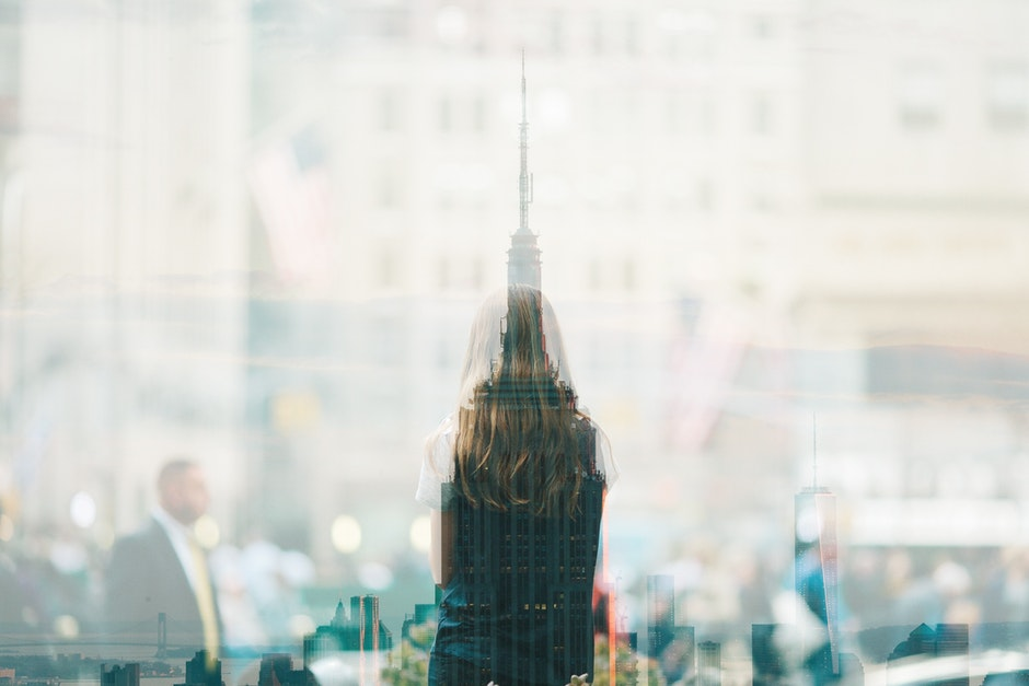 Multiple exposure image of a girl and a skyline