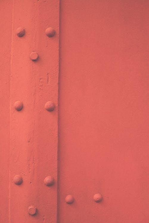Close-Up Shot of a Red Metal Door