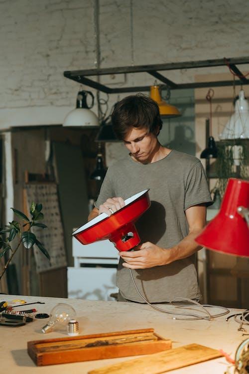 Man in Gray Crew Neck T-shirt Holding Red Ceramic Mug