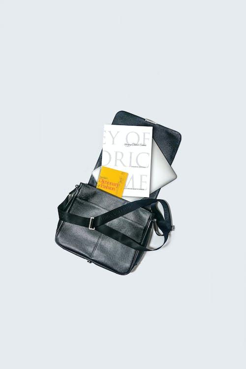 Black Leather Sling Bag Beside Black Leather Sling Bag