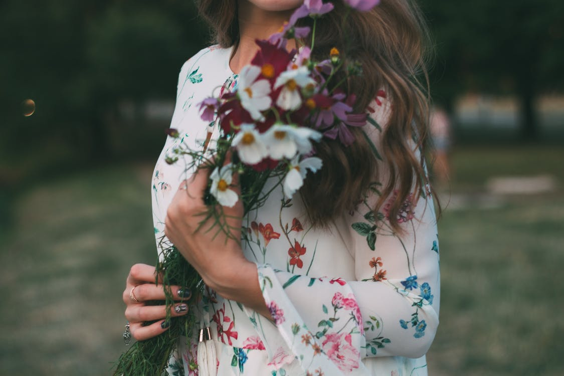 Woman in White Red and Green Floral Dress
