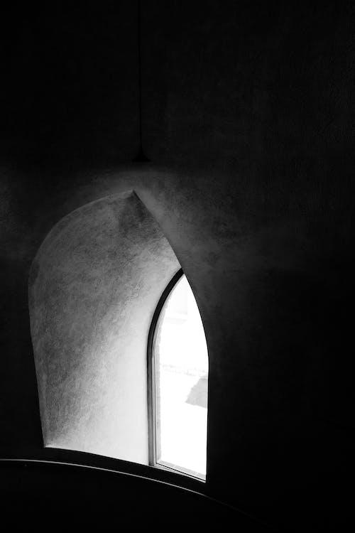 Window in dark room in daytime