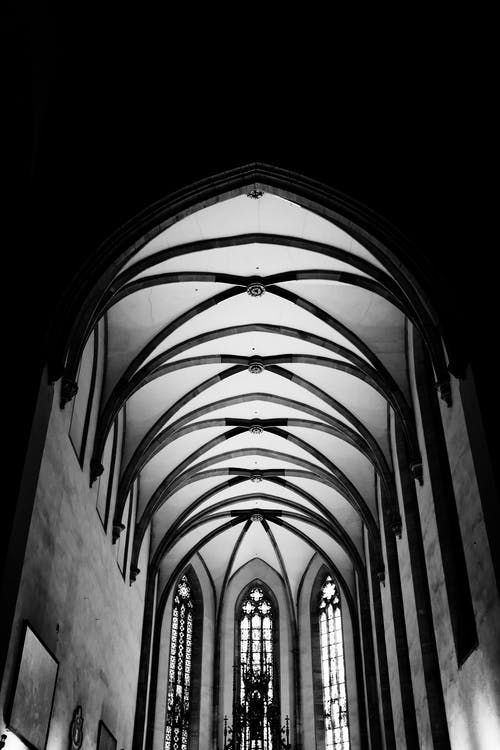 Arched old catholic cathedral with geometrical ceiling