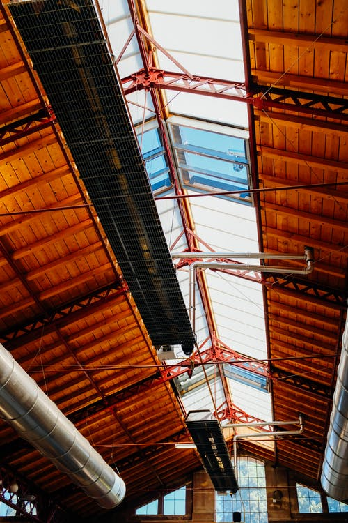 Ceiling with windows and metal constructions