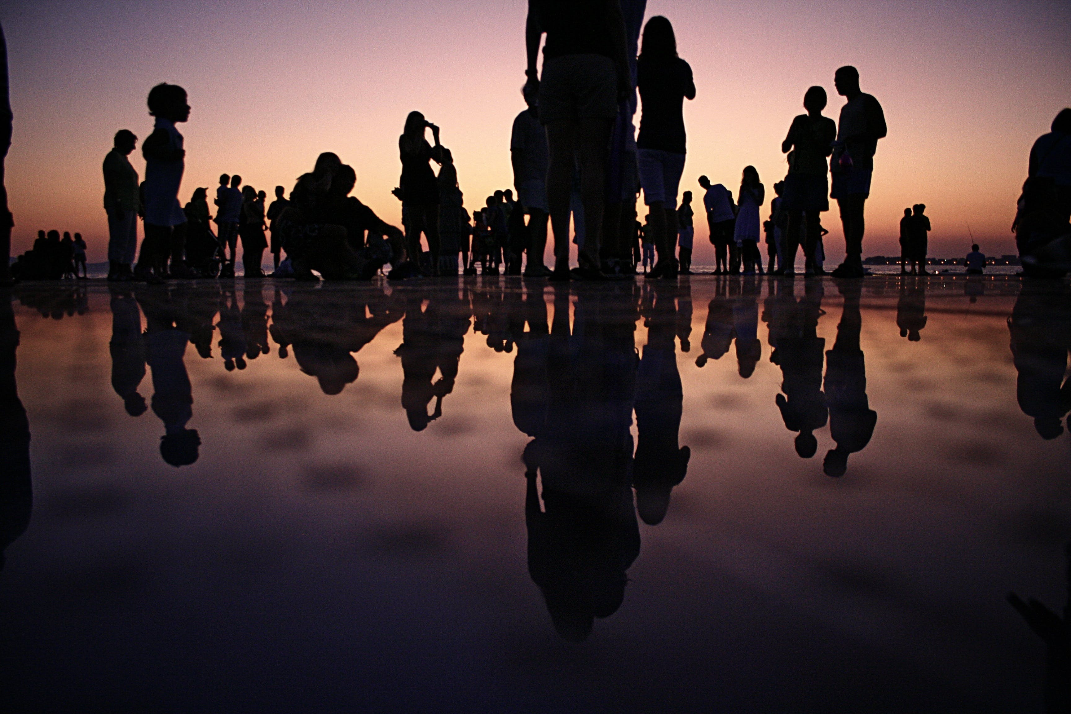Free stock photo of sunset, people, crowd, reflections