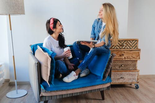 Female friends laughing in living room