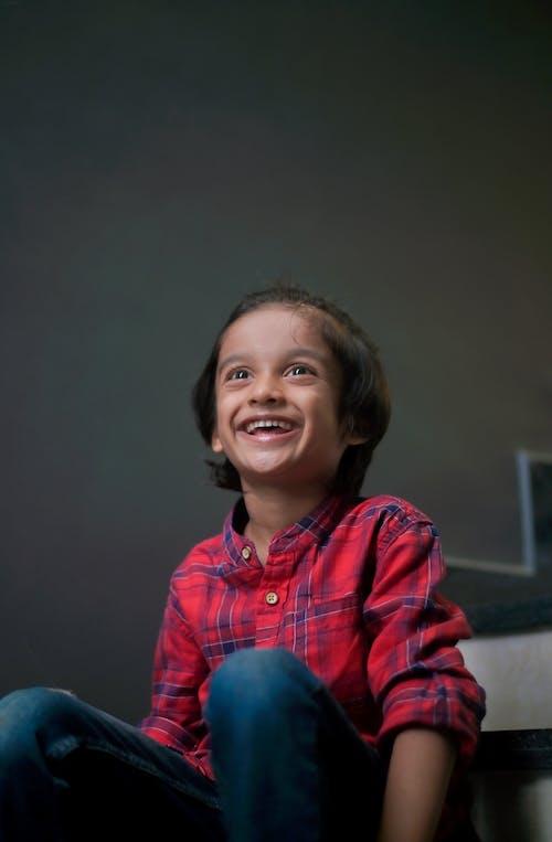 Smiling boy sitting in room