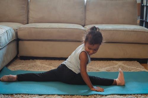 Focused girl doing leg split