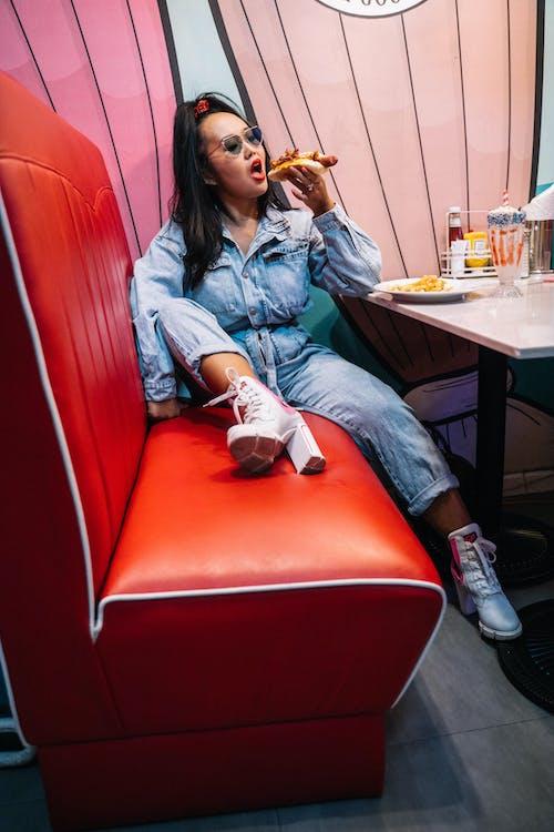 A Woman Eating A Hotdog Sandwich